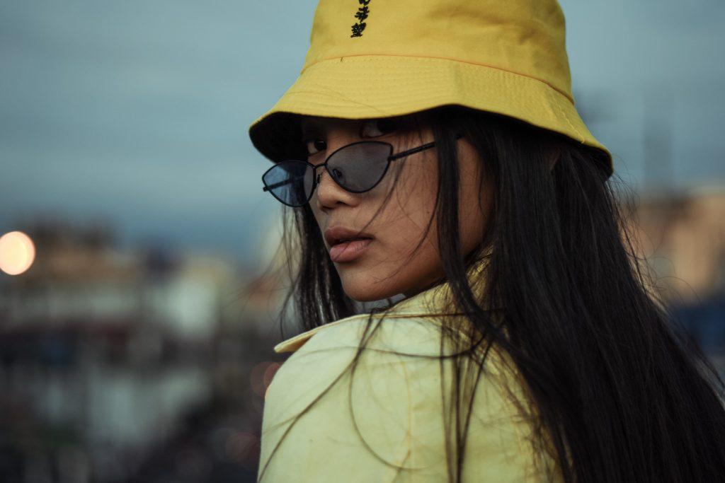 girl wearing a bucket hat